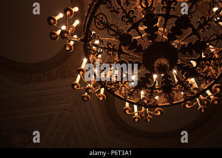 Gilt candelabrum inside the State Hermitage Museum in St. Petersburg, Russia - Stock Photo