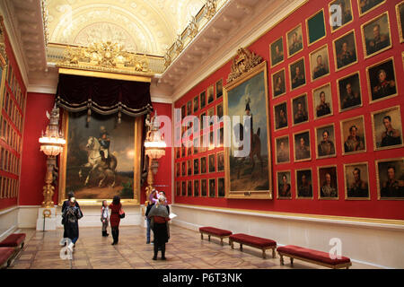 People looking at artworks inside the Hall of Fame Portrait Gallery of the 1812 Patriotic War at the State Hermitage Museum in St. Petersburg, Russia - Stock Photo