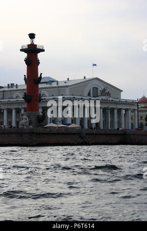 Exterior view of the Naval Museum, the Old Stock Exchange and the Rostral Column on Vasilyevsky Island in St. Petersburg, Russia - Stock Photo