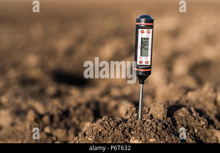 Soil meter for measured  PH, temperature and moisture at field - Stock Photo