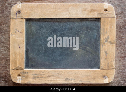 Blackboard with wooden frame, blackboard on old wood background - Stock Photo