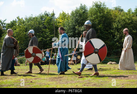 Saxon Viking battle re enactment in summer - Stock Photo