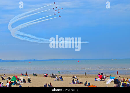 The Royal Air Force Aerobatic Team, the Red Arrows,performing a spectacular display at Swansea Air Show which takes place over Swansea Bay each summer - Stock Photo
