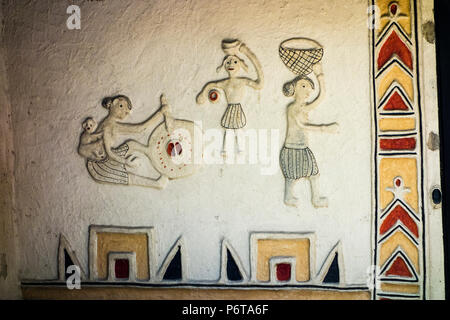 Exhibit of wall decoration on Gond Hut of Mandla District in the National Handicrafts and Handlooms museum, New Delhi, Delhi, India - Stock Photo