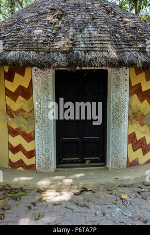Exhibit of a circular Banni hut thatched with local weeds and the shape protects from desert winds, National Crafts Museum, New Delhi, Delhi, India - Stock Photo
