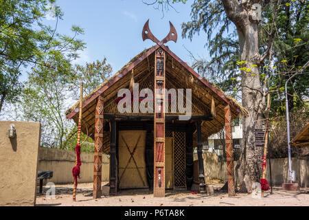 Konyak Morung or traditional Men's House for the men of Konyak Tribe in Nagaland, National Handicrafts and Handlooms Museum, New Delhi, Delhi, India - Stock Photo