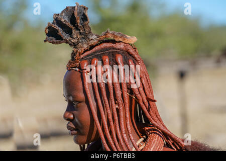 DAMARALAND NAMIBIA - MAY 21 2018; Himba tribal village and people one woman's traditional hairstyle - Stock Photo