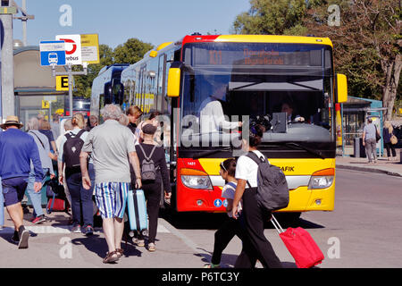 Kalmar, Sweden - June 28, 2018: Passengers at the Kalmar central station enter the public transportation bus with destination Byxelkrok via Borgholm o - Stock Photo