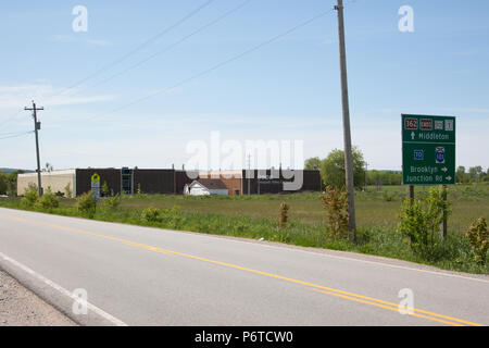 June 4, 2018- Middleton, Nova Scotia: The Annapolis Valley Campus of the Nova Scotia Community College, with a road sign indicating the communities of - Stock Photo