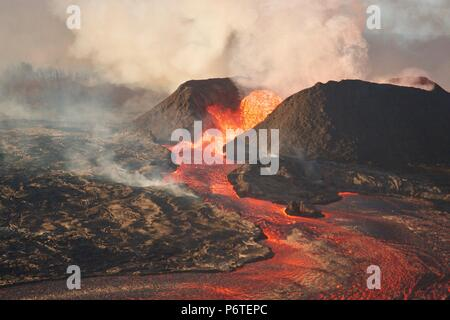 A massive lava fountain spewing magma 180 feet into the air from fissure 8 at the corner of Nohea and Leilani caused by the eruption of the Kilauea volcano June 30, 2018 in Hawaii. The recent eruption continues destroying homes, forcing evacuations and spewing lava and poison gas on the Big Island of Hawaii. - Stock Photo