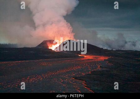A massive lava fountain spewing magma 180 feet into the air from fissure 8 caused by the eruption of the Kilauea volcano June 30, 2018 in Hawaii. The recent eruption continues destroying homes, forcing evacuations and spewing lava and poison gas on the Big Island of Hawaii. - Stock Photo