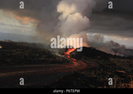 Lava fountains continue to spew magma from the 180 foot tall spatter cone with lave flowing into an open channel at fissure 8 caused by the eruption of the Kilauea volcano June 30, 2018 in Hawaii. The recent eruption continues destroying homes, forcing evacuations and spewing lava and poison gas on the Big Island of Hawaii. - Stock Photo