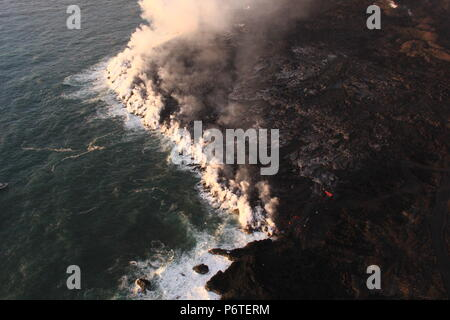 Lava from fissure 8 flows into the Pacific Ocean caused by the eruption of the Kilauea volcano June 30, 2018 in Hawaii. The recent eruption continues destroying homes, forcing evacuations and spewing lava and poison gas on the Big Island of Hawaii. - Stock Photo