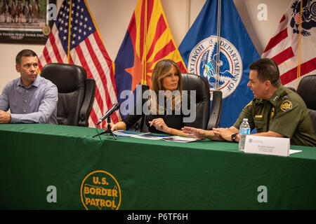 U.S. First lady Melania Trump listens to Rodolfo Karisch, right, Chief Patrol Agent, TCA Border Patrol during a roundtable discussion on immigrant children that have been separated form their parents June 28, 2018 in Tuscon, Arizona. U.S. Customs and Border Protection Commissioner Kevin McAleenan looks on from the left. - Stock Photo