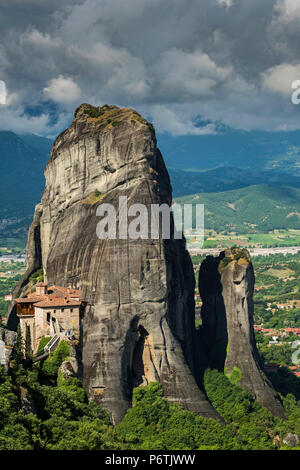 Monastery of Moni Agias Varvaras Roussanou with the spectacular massive rocky pinnacles in the background, Meteora, Thessaly, Greece - Stock Photo