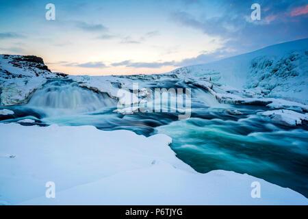 Iceland, Europe. Frozen Gullfoss waterfall in wintertime. - Stock Photo