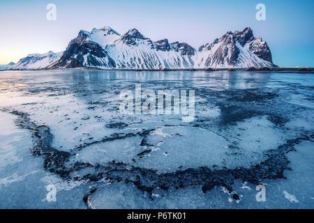 Stokksnes, Eastern Iceland, Europe. Vestrahorn mountain in a frozen winter landscape. - Stock Photo