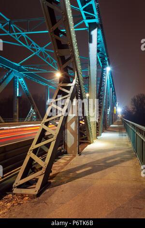 Moving car with blur light through Pilsudski Bridge at night in Torun. Poland. Europe. - Stock Photo