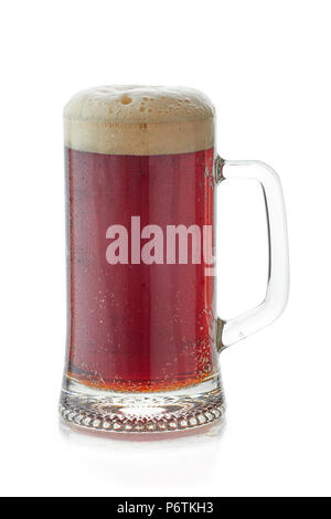Mug of dark beer with foam head on white - Stock Photo