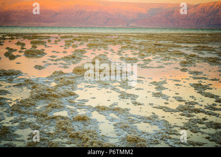 Sunset view of salt formations in the Dead Sea, between Israel and Jordan - Stock Photo