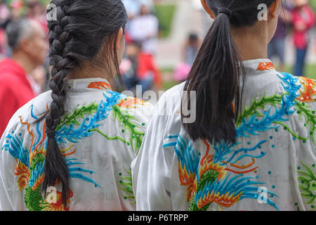 Two young Asian  girls at Calgary's Canada Day in downtown Chinatown - Stock Photo