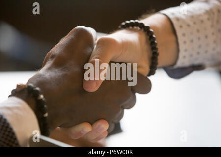 Multiracial people handshaking greeting with achievement or succ - Stock Photo