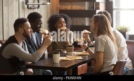 Smiling multiracial colleagues enjoying lunch spending work brea - Stock Photo