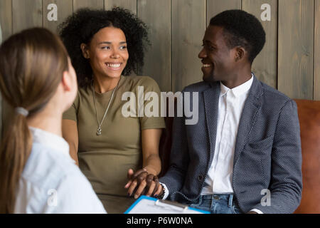 Happy African American couple reconciled after successful psycho - Stock Photo