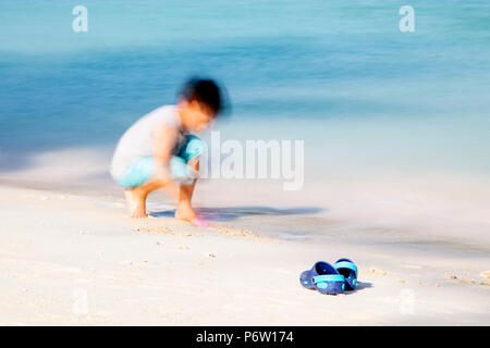 Young Boy Playing on the Beach Long Exposure - Stock Photo