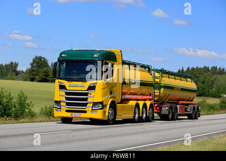 Colorful Next Generation Scania R580 V8 tank truck of K Pekki Oy hauls load along highway on a beautiful day of summer. Salo, Finland - July 1, 2018. - Stock Photo