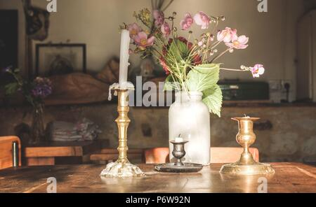candle on a table in a restaurant - Stock Photo