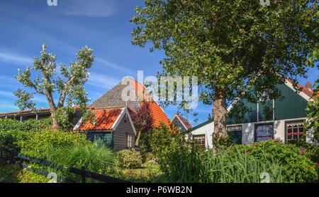 colorful dutch house on a clear and bright day in the Netherlands - Stock Photo