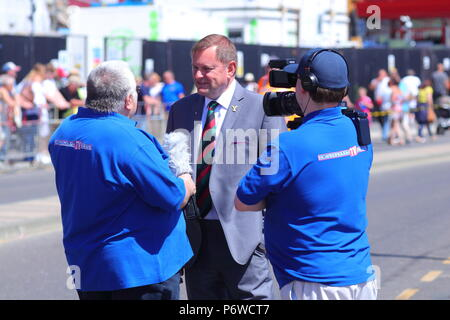 Sir Gary Verity being interviewed by Barry Robinson of Scarborough Tv News during Scarborough Armed Forces Day. - Stock Photo