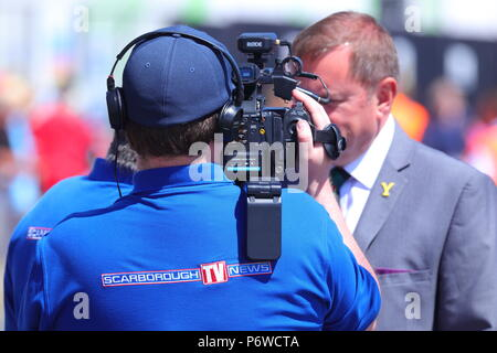 Sir Gary Verity being interviewed by Scarborough Tv News during Scarborough Armed Forces Day. - Stock Photo
