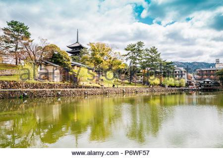 Sarusawa Pond and Kofukuji temple in Nara, Japan - Stock Photo