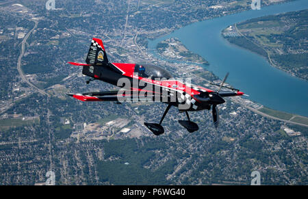 Aerobatic pilot Rob Holland of Nashua, N.H. flies his MX2 aircraft above Niagara Falls, N.Y., June 8, 2018, during the Thunder of Niagara International Air Show hosted by Niagara Falls Air Reserve Station, N.Y. (U.S. Air Force photo by Tech. Sgt. Steph Sawyer) - Stock Photo