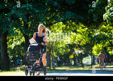 Aberystwyth, Wales, UK. 3rd July, 2018. UK Weather: People walking Plas Crug park on another hot and sunny Morning in Aberystwyth Wales. The prolonged period of extreme heat and very dry weather is forecast to last for another two weeks, bringing the threat of drought and water shortages to some areas. photo Credit: keith morris/Alamy Live News - Stock Photo