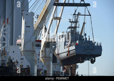 Sassnitz, Germany. 03rd July, 2018. A coast guard boat for Saudi Arabia being loaded on a transport ship in the port of Mukran. The Luerssen Group from Bremen, owner of the Wolgaster Shipyards, received an order valued in the billions of euros for the construction of a fleet of new patrol boats for Saudi Arabia and began with construction works in 2015. Only in March this year, however, did the federal government approved the delivery to the Kingdom of 8 further ships. Around 300 workers are employed by the Wolgaster Luerssen Shipyards. Credit: Stefan Sauer/dpa-Zentralbild/dpa/Alamy Live News - Stock Photo