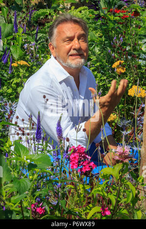London, UK. 2nd-8th July 2018. RHS Hampton Court Flower Show. Chef and TV celebrity Raymond Blanc in the RHS garden Grow Your Own with The Raymond Blanc Gardening School.     - Designers: Allister Dempster & Rossana Porta  - Sponsor: n/a - Stock Photo