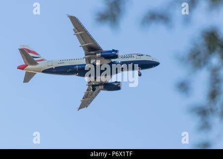 British Airways Airbus A319, Landing At Heathrow Airport In London, United Kingdom - Stock Photo