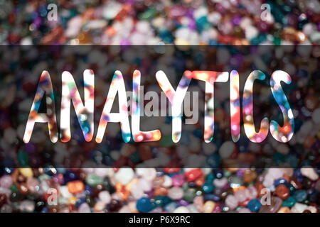 Text sign showing Analytics. Conceptual photo Data Analysis Financial Information Statistics Report Dashboard Blurry candies candy ideas message refle - Stock Photo