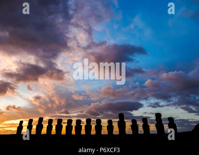 Moais in Ahu Tongariki at sunrise, Rapa Nui National Park, Easter Island, Chile - Stock Photo