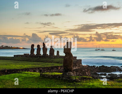 Moais in Tahai Archaeological Complex at sunset, Rapa Nui National Park, Easter Island, Chile - Stock Photo