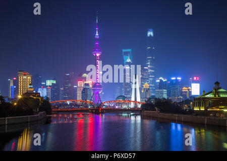 Pudong skyline across the Suzhou Creek and Waibaidu bridge, Shanghai, China - Stock Photo