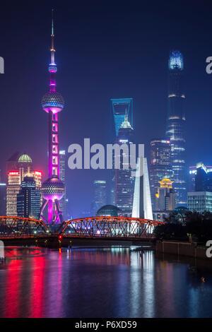 Pudong skyline across the Suzhou Creek and Waibaidu bridge, Shanghai, China