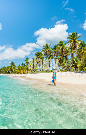 Canto de la Playa, Saona Island, East National Park (Parque Nacional del Este), Dominican Republic, Caribbean Sea. Beautiful woman on a palm-fringed beach (MR). - Stock Photo