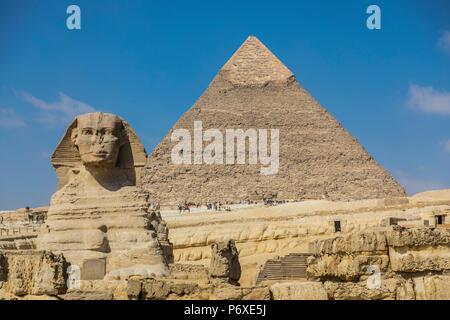 Sphinx and Pyramid of Khafre (Chephren), Pyramids of Giza, Giza, Cairo, Egypt - Stock Photo