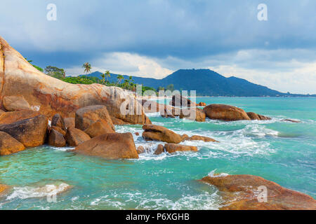 Azure sea and the red rocks of the island of Koh Samui in Thailand. - Stock Photo