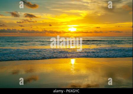 Colorful sunset on Karon beach. Phuket Island in Thailand. - Stock Photo