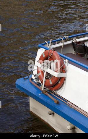 Lifebuoys with the name of the city in Russian Saint-Petersburg on the water bus - Stock Photo